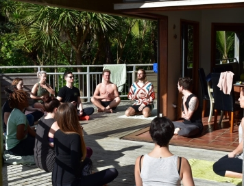 Teaching Yoga to help shake off those hangovers, at a weekend away with friends in New Zealand